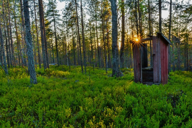 This old, well air-conditioned outhouse lies on a small hill in the woods of  Pudasjarvi, Finland. It's probably missing ...
