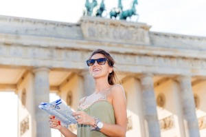 Tourist with map finding landmarks near Brandenburg Gate, Berlin - iStock image