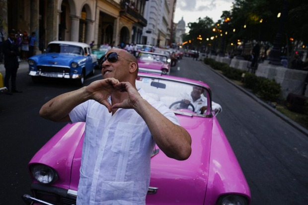 "Actor Vin Diesel gestures to the crowd watching the presentation of Fashion designer Karl Lagerfeld's ""cruise"" line for ..."