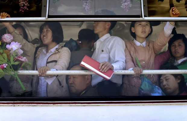 North Koreans ride on an electric trolley bus  in Pyongyang, North Korea.