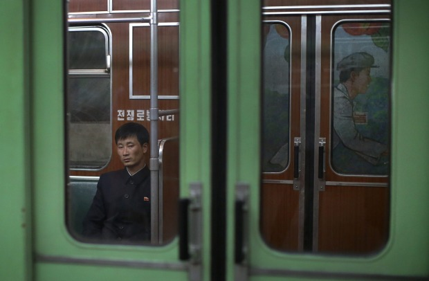 A North Korean man rides in a subway car on in Pyongyang, North Korea.