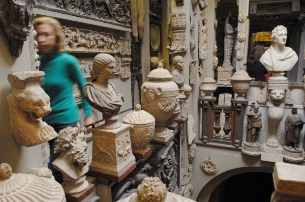 A visitor walks through an exhibition room at the Sir John Soane's Museum in London, UK.