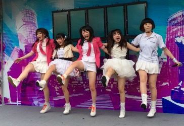 A girl band performing at lunch time at Shibuya railway station in Tokyo.