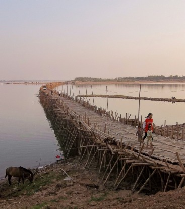 Bamboo Bridge Cambodia The Bridge spans the mighty Mekong River from the town of Kampong Cham (about 125 kms from Phnom ...