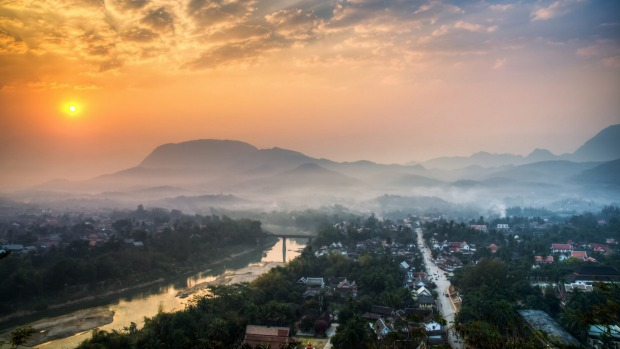 A world away: Sunrise at Luang Prabang.
