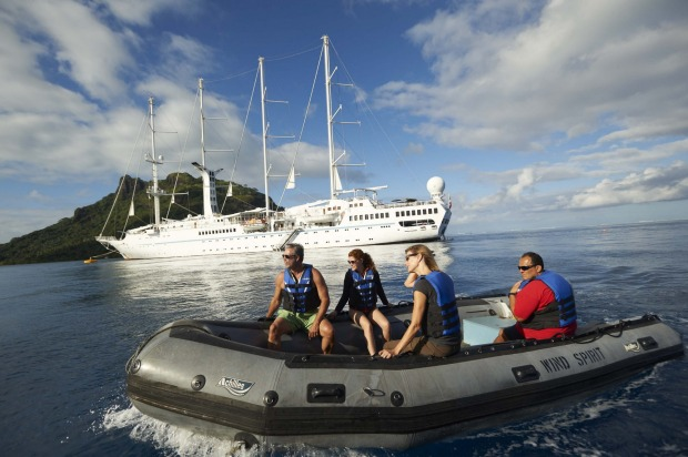 Guests travel by tender into the islands of French Polynesia for ma.rine or land excursions or just to go for a cold ...