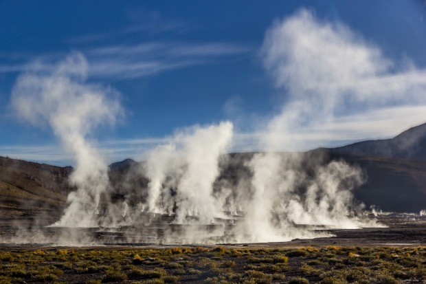 Steam pours from the Tatio Geysers shortly after sunrise, near San Pedro de Atacama, Chile.