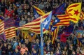 Barcelona's supporters wave Estelada flags during the Spanish La Liga football match between FC Barcelona and Eibar at ...