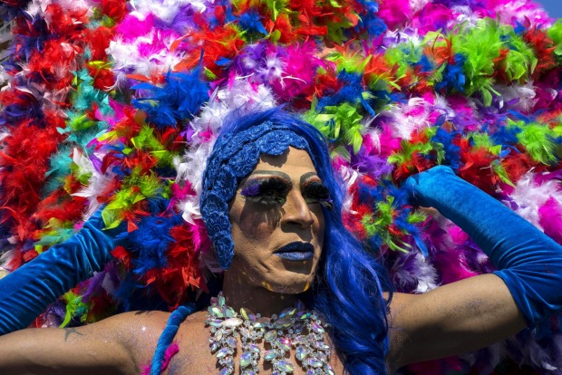 A member of Cuba's LGBT community wears a costume in a gay pride parade in Havana, Cuba.