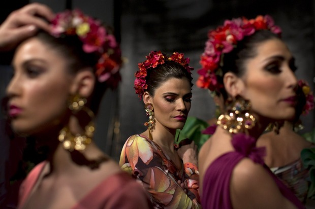 Models wait in backstage during the first day of the SIMOF 2015 in Seville, Spain.
