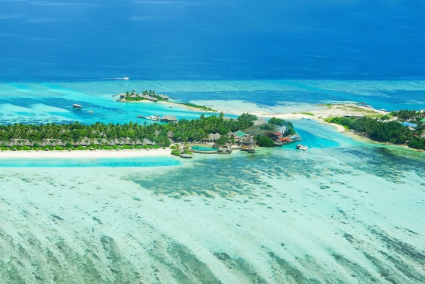 TBora Bora with water villas and coral reef.