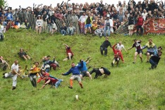 Competitors take part in the annual unofficial cheese rolling race at Cooper's Hill in Brockworth,  England  Monday May ...
