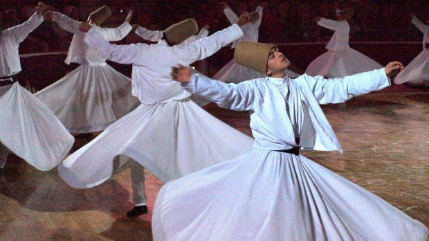 Sufi whirling dervishes in Konya, Turkey, during the annual Mevlana Festival.