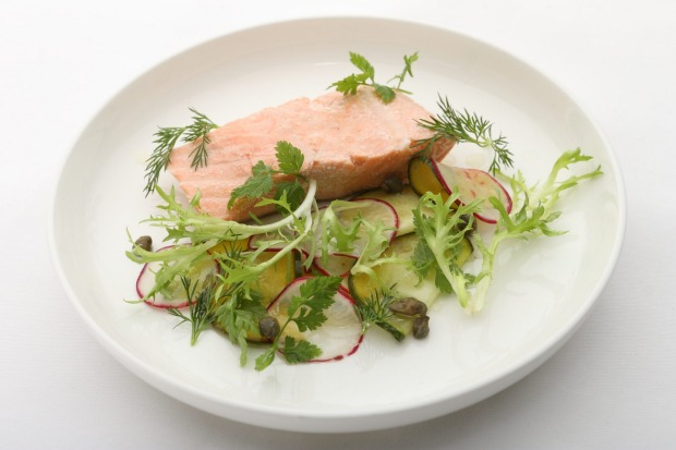 Ocean trout confit with pickled cucumbers and capers.