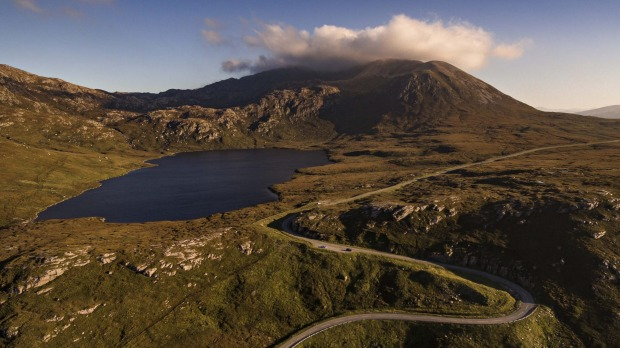 Other-worldly: Driving on NC500 near Loch Assynt.