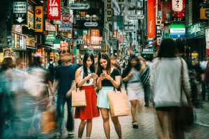 Japanese girls hanging out on Shibuya streets of Tokyo.