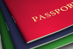 A stack of generic passports on an isolated white studio background