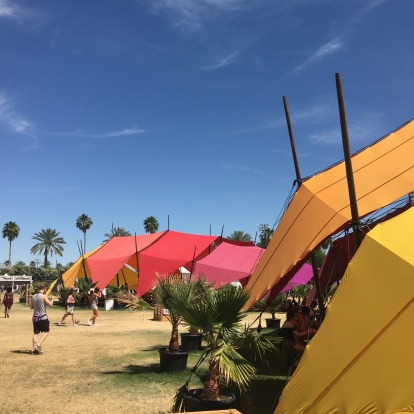 Colourful tents under blue skies.