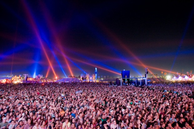 Main stage crowds at night for headline acts.