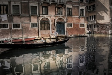 One of the many Gondola traveling on the canals of Venice. Loved the light, reflections on the gentle moving water.