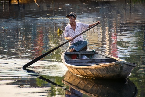 This boatman image was taken in Hoi An, Vietnam. For me, it captures the essence of Vietnam: peace, colour, hard work, a ...