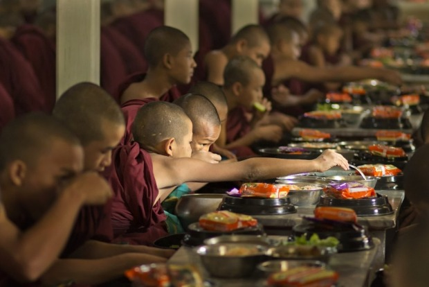 In late morning each day monks line up for their meal at Maha Ganayon Kyaung monastery in Mandalay, Myanmar. Queuing up ...