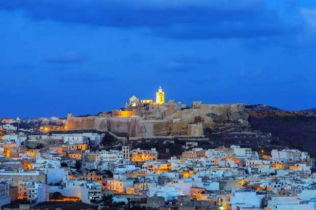 Gozo Island, Victoria, Cittadella and surrounding townscape at night.