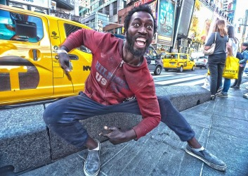 I met this man who was sitting sedately,when I first saw him in Times Square New York. However he came alive in front of ...