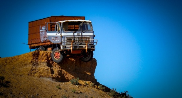 Travelling in outback Western Australia we come across the interesting situation of truck perched perilously on a red ...