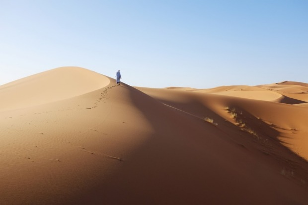During the warmest part of the year, Moroccans come to Erg Chebbi to be buried neck-deep in the hot sand for a few ...