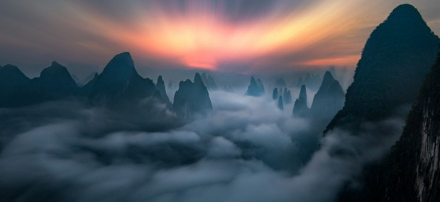 This was taken at the break of dawn on a mountain top in Guilin, China. On a fine day, one can see the city that ...