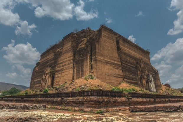 The massive monolithic unfinished Mingun Stupa an hour's boat ride from Manadaly, Myanmar. To get a sense of scale try ...