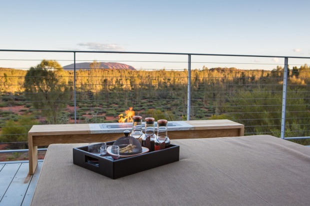A warming fire on your private deck at Longitude 131 near Uluru.