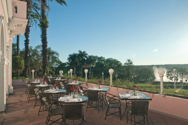 The spray from Iguacu Falls is visible from the grounds of Hotel das Cataratas.