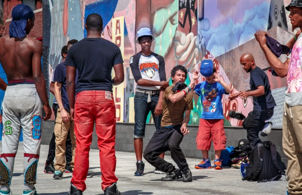 Teens in Harlem take to the street corners and blast loud music while practicing their dance moves.