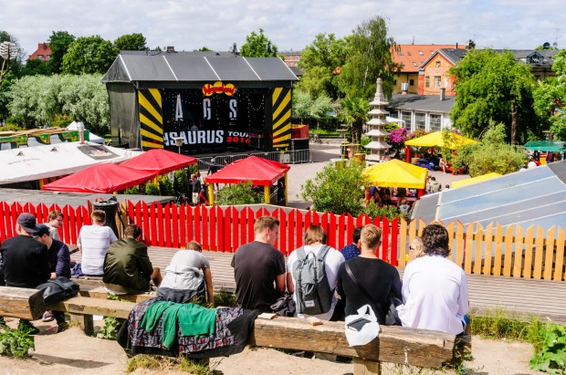 People sitting and relaxing overlooking the main concert stage in Freetown Christiana, Copenhagen.