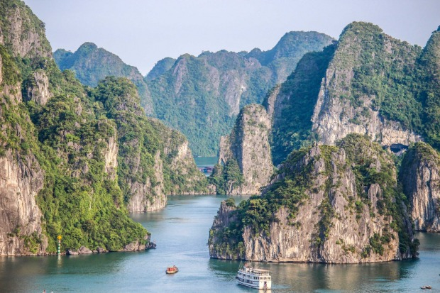 This photo was taken in the spectacular Ha Long Bay in Vietnam. This formation of limestone islands covers an ...