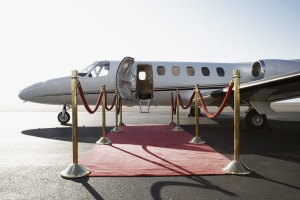 Fly the exclusive skies with a private jet and champagne all the way.