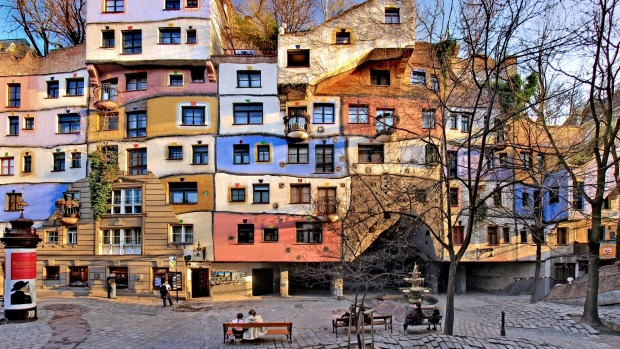The central Hundredtwasserhaus apartment block with its colourful higgledy-piggledy façade revealing the influence ...