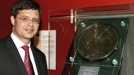 Former Dutch Prime Minister Jan Peter Balkenende next to the Hartog pewter plate during its temporary loan to the State ...