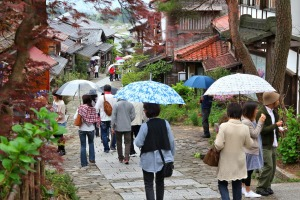 People visit old town of Magome. Magome-juku was a historic post town of famous Nakasendo trail between Kyoto and Edo.