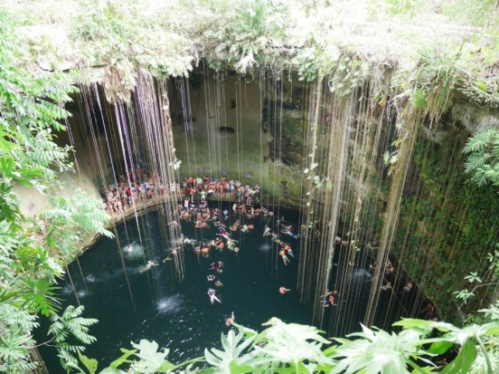 Swimming in the magnificent Grand Cenote, just outside of Tulum, Mexico.