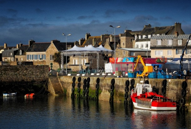 The picturesque fishing town of Roscoff on the north coast of Brittany, France, is known for its 16th century granite ...