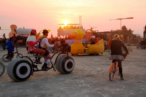 A sunset gathering on the playa during the annual Burning Man festival in the desert.