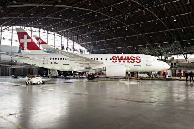 A Bombardier CS 100 C Series jet, operated by Swiss International Air Lines, stands on display during its delivery ...