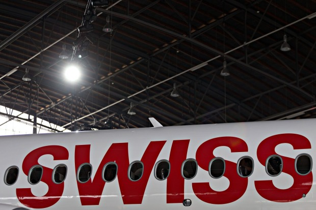 A Bombardier CS 100 C Series jet, operated by Swiss International Air Lines,  on display during its delivery ceremony in ...