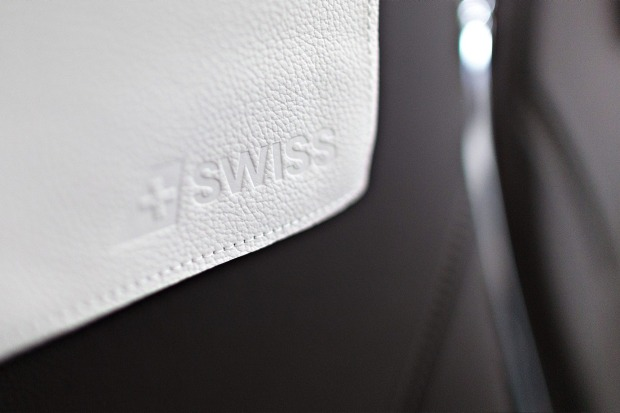 A leather headrest cover inside the cabin of a Bombardier CS 100 C Series jet, operated by Swiss International Air Lines.