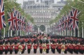 The Queen rides in a carriage along the Mall during the Trooping The Colour parade at Buckingham Palace in June 2016. ...
