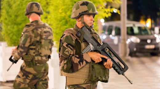 French soldiers stand guard by the sealed off area of an attack after a truck drove on to the sidewalk and ploughed ...