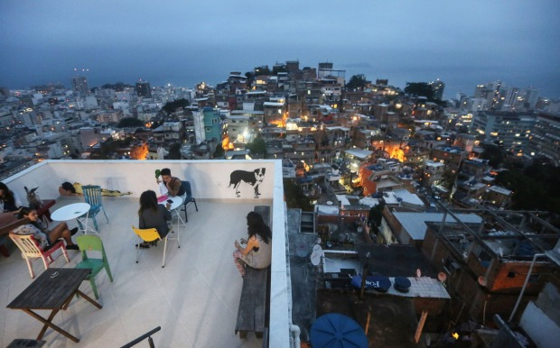Guests gather on the terrace of the Tiki Hostel in the Cantagalo favela.